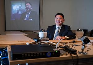 Kevin Wan, president and CEO of EP Technology Corp., shows off some of the company's video-security equipment at its offices in Champaign in January 2012.